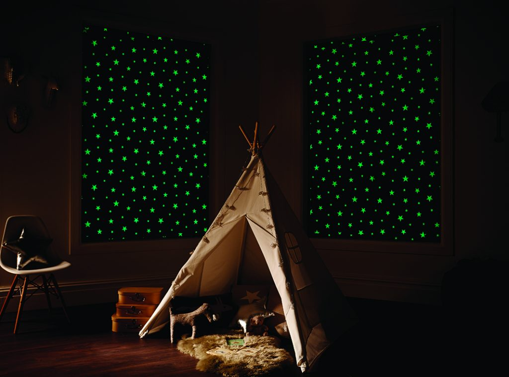 Glow in the dark blinds, dark room with green glow from the blinds.