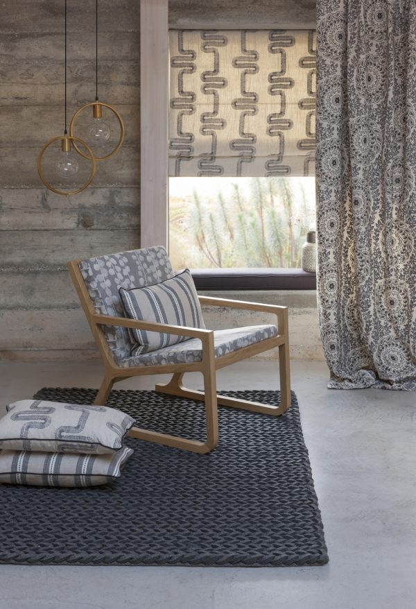 Taupe patterned roman blinds and curtains with matching cushion