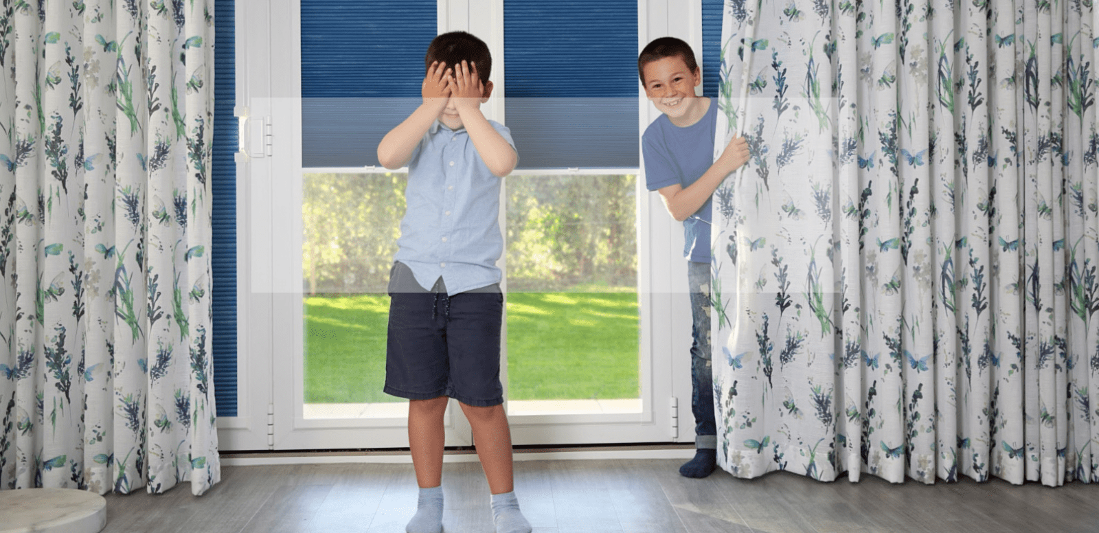 Two boys playing hide and seek in curtains | Norwich Sunblinds