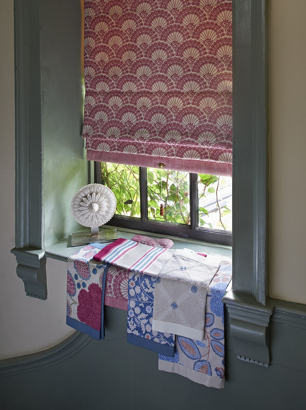 Pink patterned Roman blinds