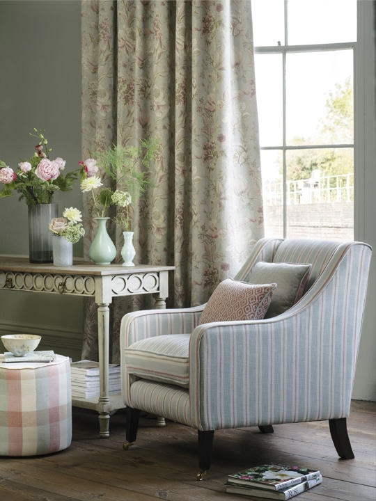 Cream and dusty pink floral curtains in living room