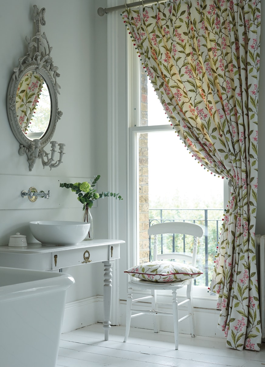 curtains with dainty pink flower and blossom design with green leaves on a cream background