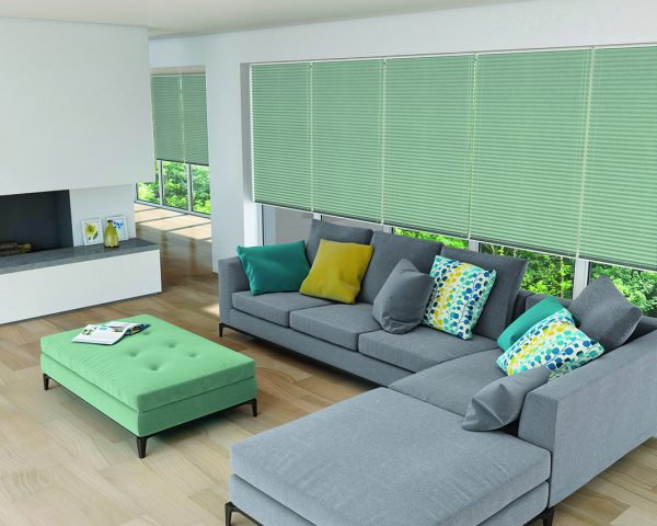 Grey sofa and pastel pleated blinds