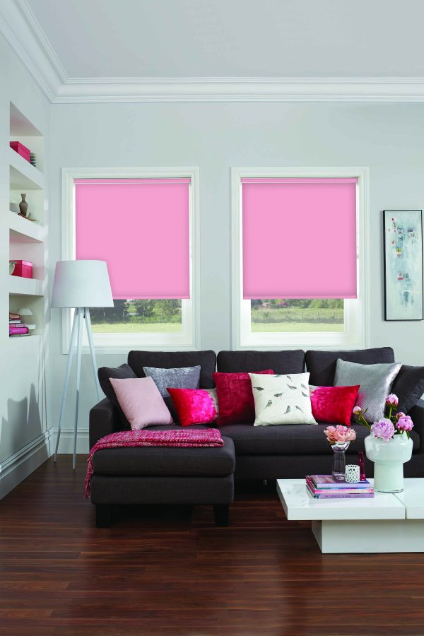 Bright pink roller blinds in living room
