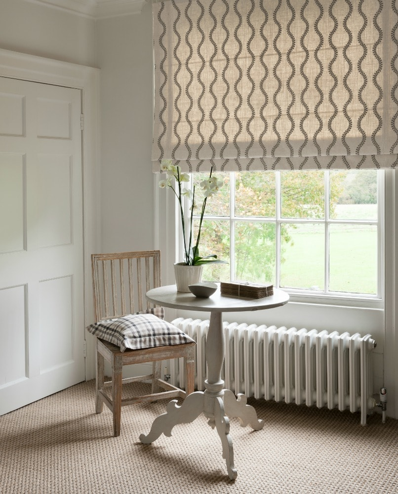 Cream and fawn patterned roman blind