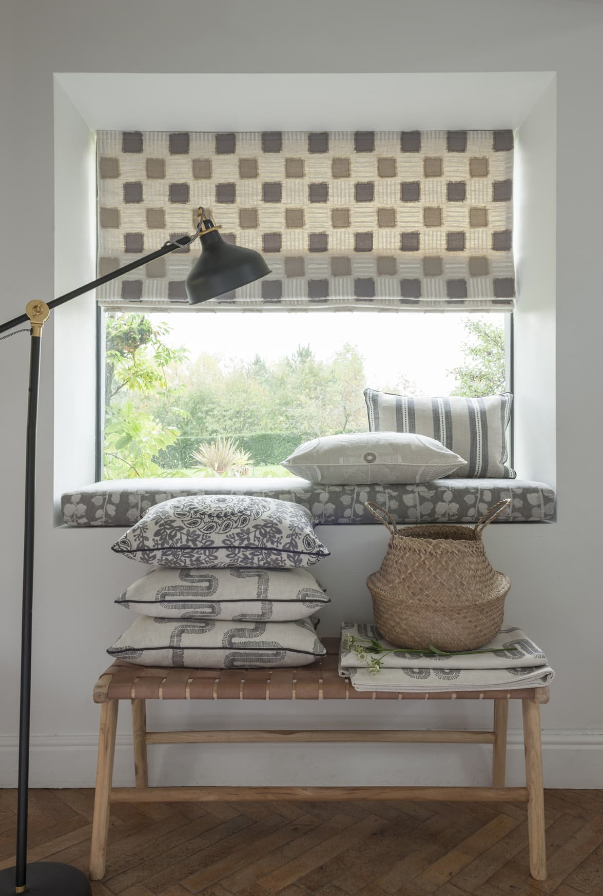 Cream and tan chequered fabric design in roman blinds