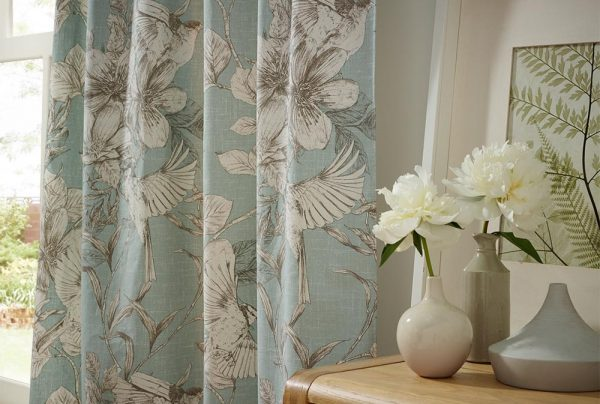 Powder Blue Floral Curtains in a Living Room. - Curtains Norfolk - Norwich Sunblinds