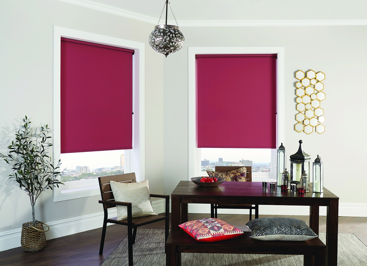 Pomegranate coloured roller blinds in living room