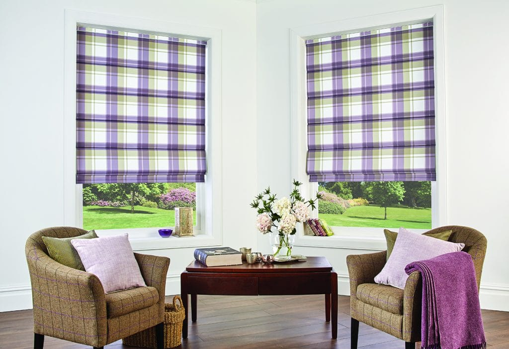 Checked pattern roller blinds in lilac, green and cream design