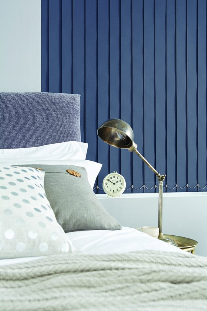 Blue vertical blinds in a bedroom