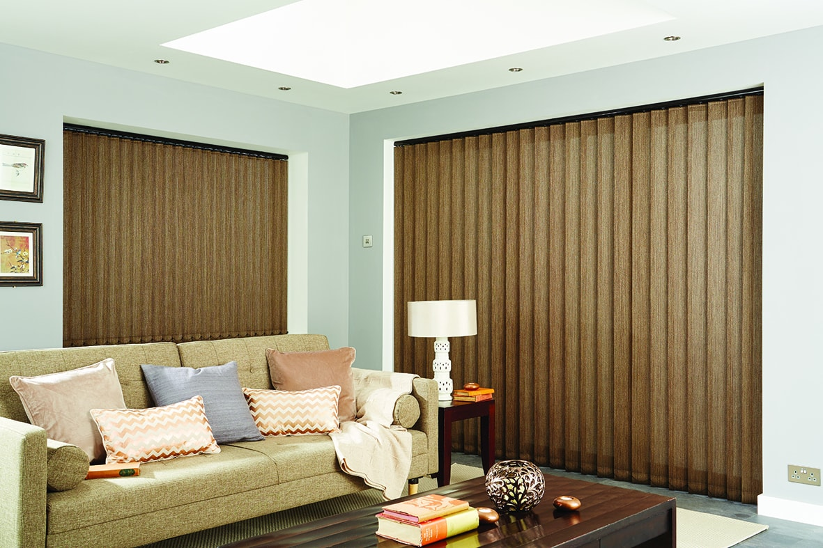 Floor to ceiling closed bronze vertical blinds in living room