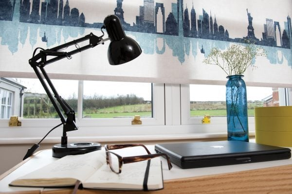 Roller blinds in Cosmopolitan fabric by RA Iriwn