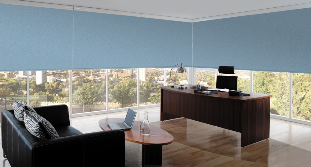 Commercial blinds in Sundown Airforce blue fabric by Louvolite