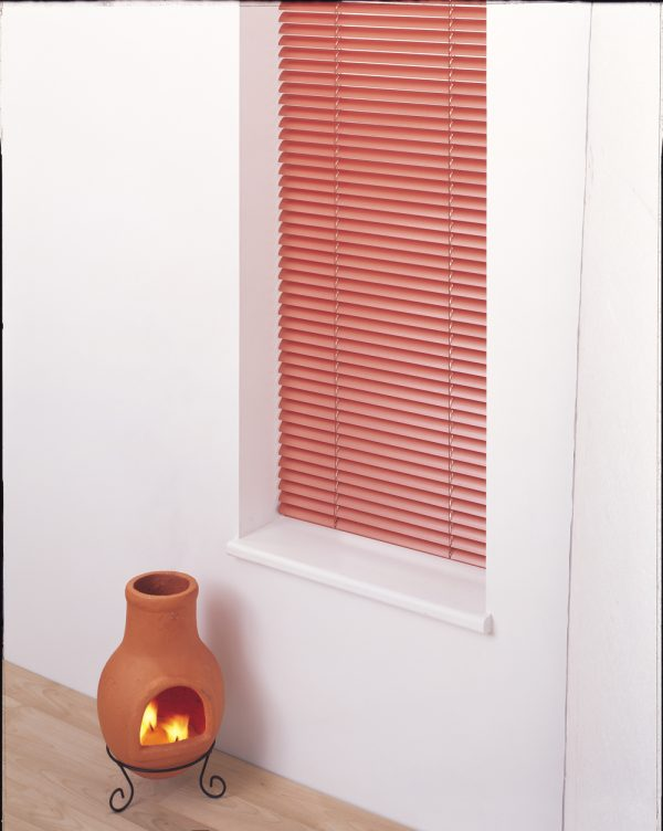 Terracotta adds a warm glow, ideal for living room blinds