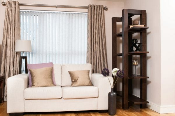 Vertical blind with complementary curtains in lounge