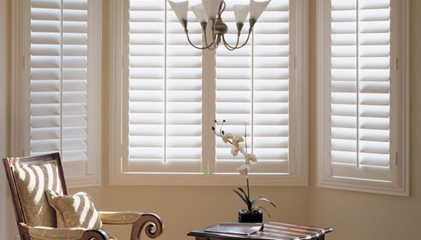 Cream shutters in bay window - Shutters Norfolk - Norwich Sunblinds