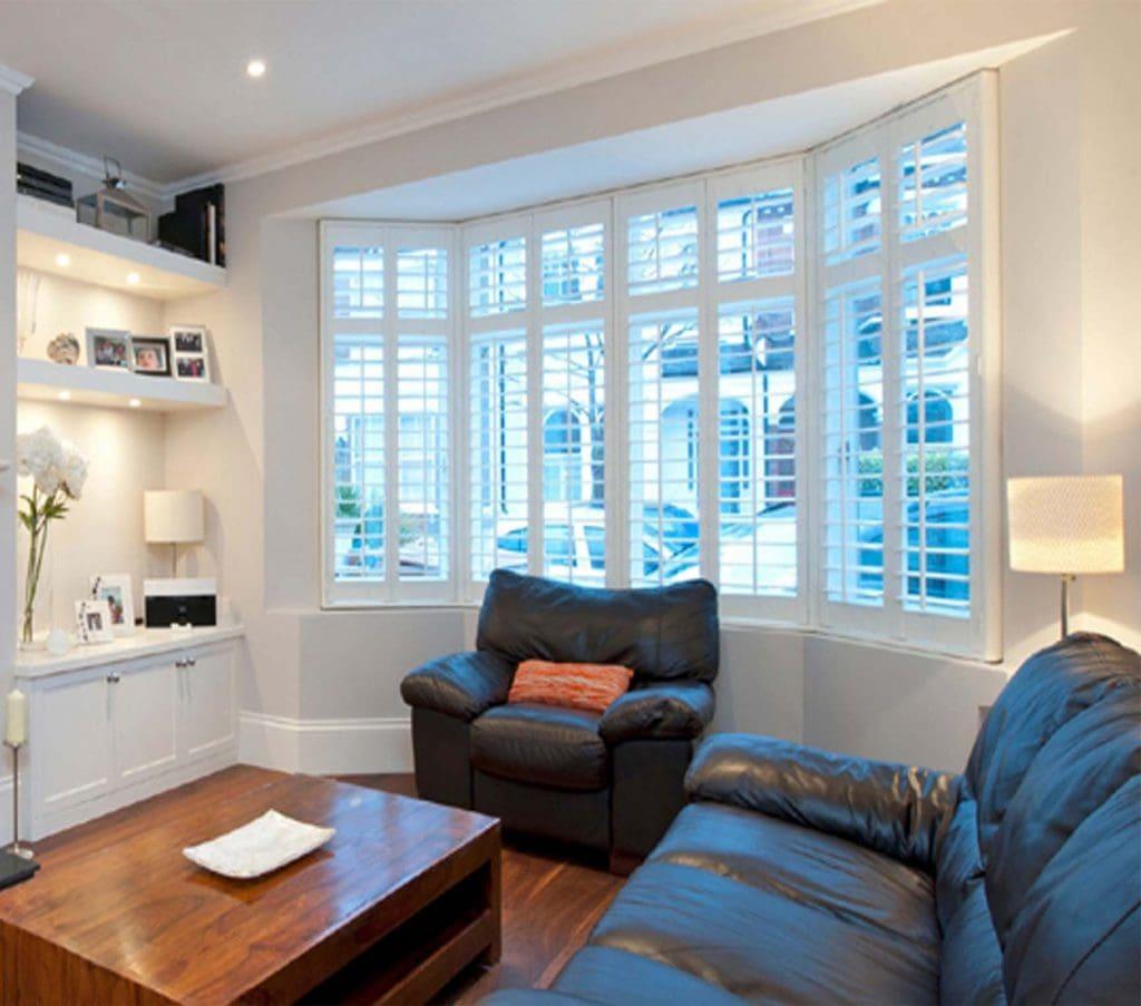Shutters in living room bay window - Shutters Norfolk - Norwich Sunblinds