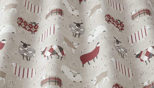 Fabric sample with red and white sheep on taupe background
