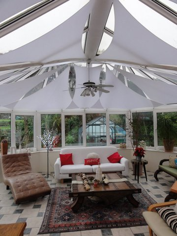 Sails provide shade in a conservatory.