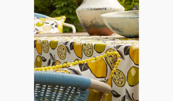 Lemon and lime patterned tablecloth and seat cushions outdoors