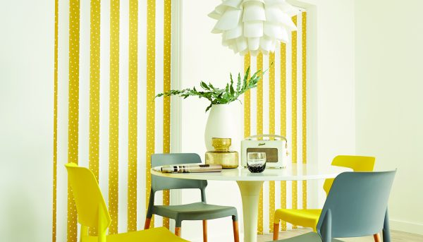Vertical blinds in dining area with alternate Yellow and white louvres