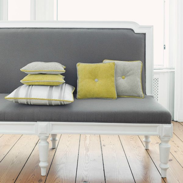 Modern grey sofa with yellow and cream cushions