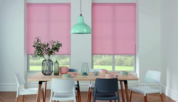 Pink roller blinds in dining room
