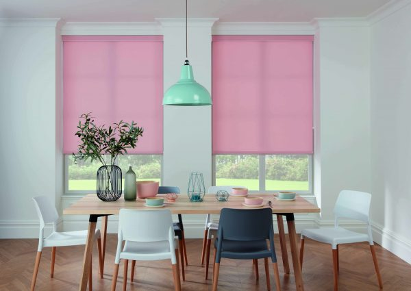 Pink roller blinds in dining room