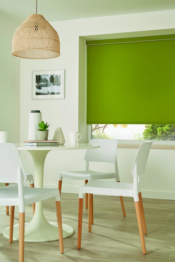 Bright green roller blind in kitchen/ diner