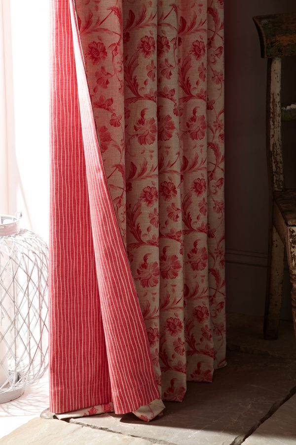 Close up of thick curtain with pink floral pattern