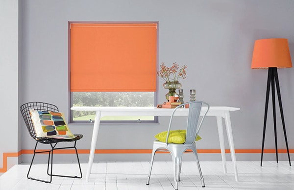 Roller blind in Carnival Cantaloupe fabric by Louvolite