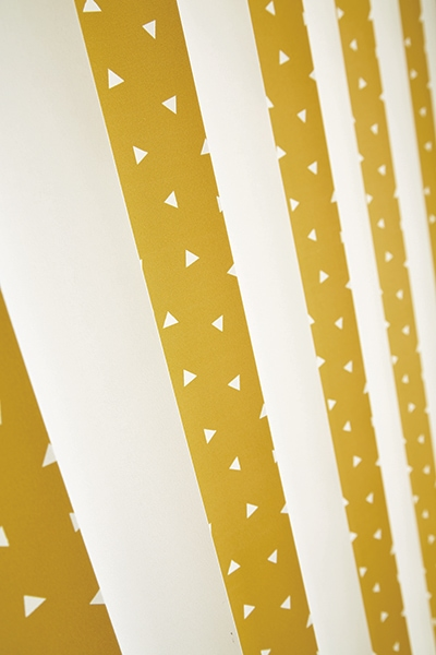 Vertical blinds in Pico Mustard Carnival fabric by Louvolite