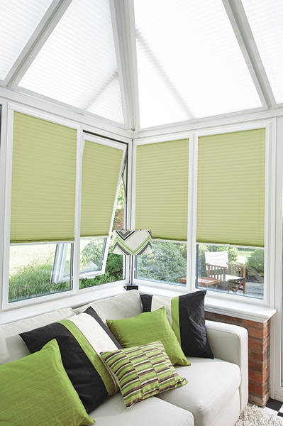 A practical choice Perfect Fit Pleated Basix Pale Green fabric from Louvolite