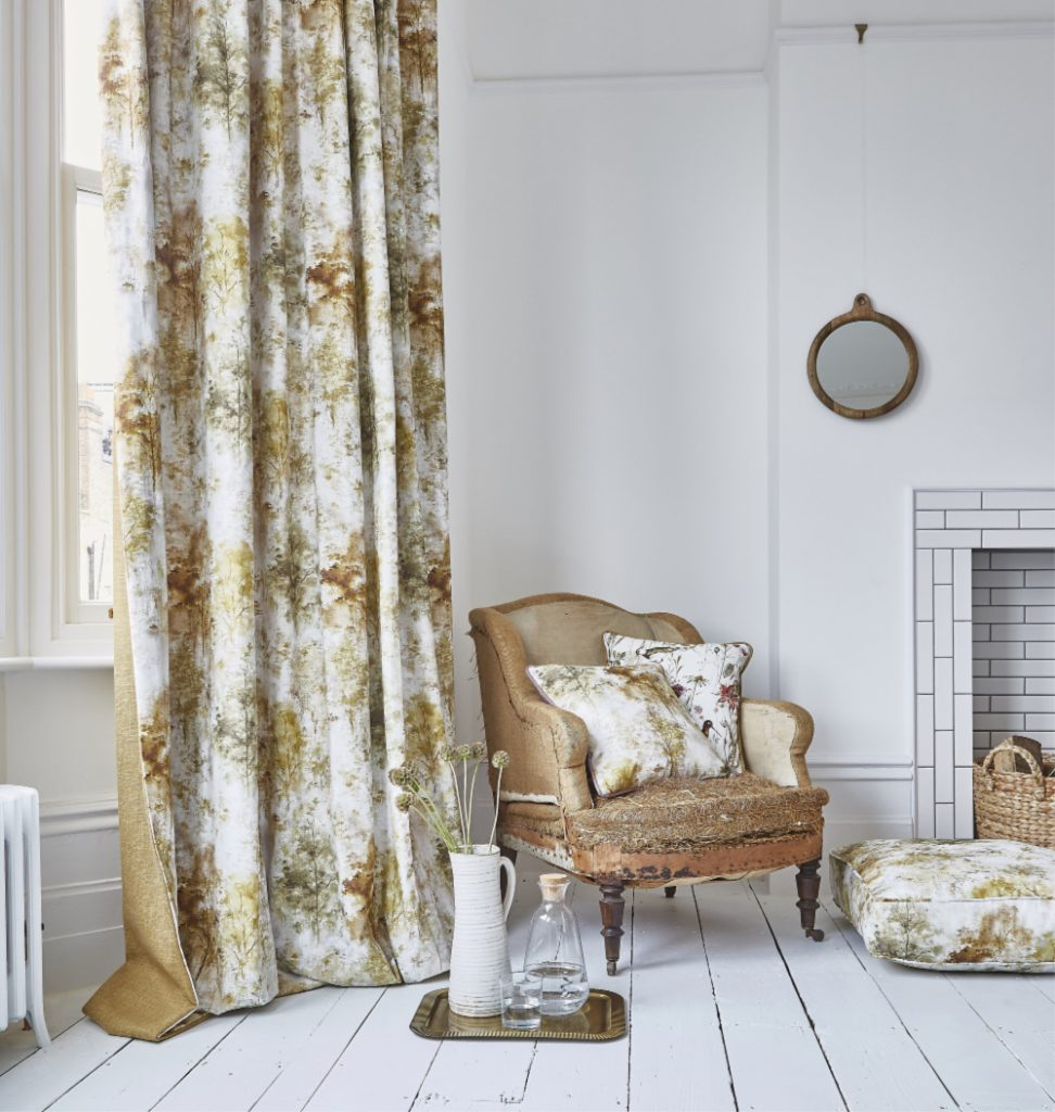 Curtains with fawn pattern on white background in white living room.