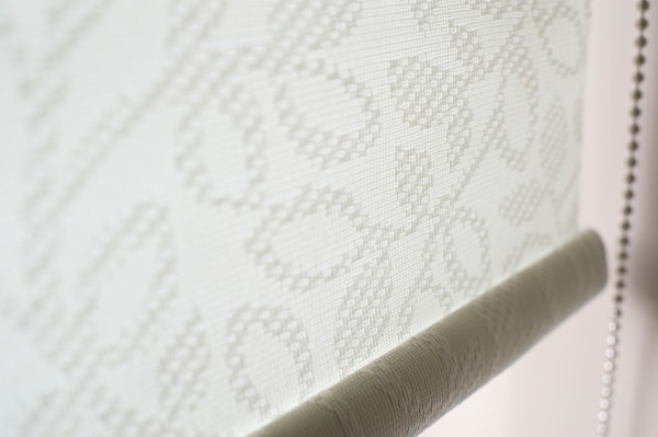 Close up of textured white roller blind