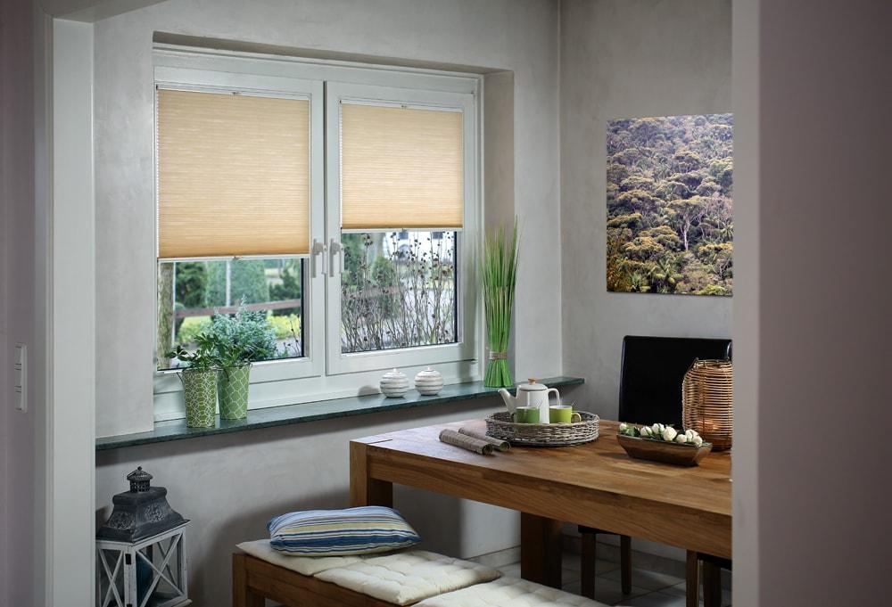 Cream roller blinds in kitchen