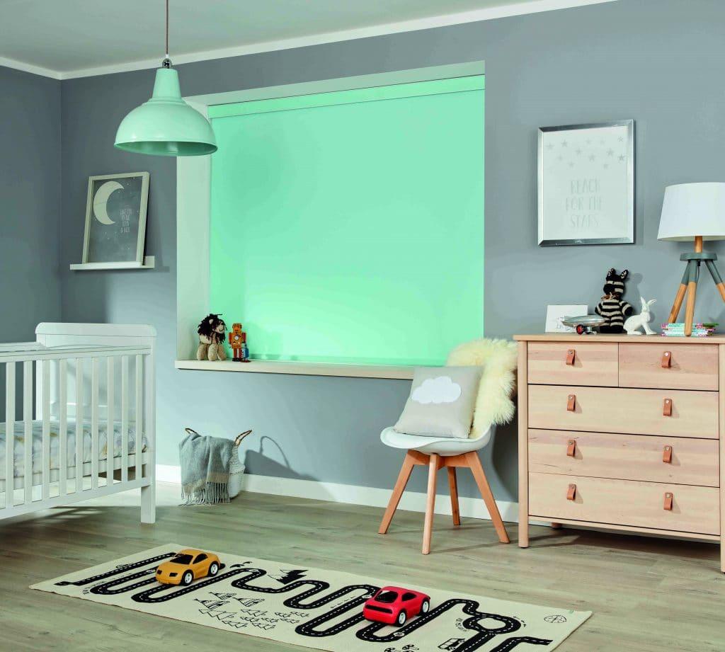 Aqua coloured blackout blind in child's bedroom
