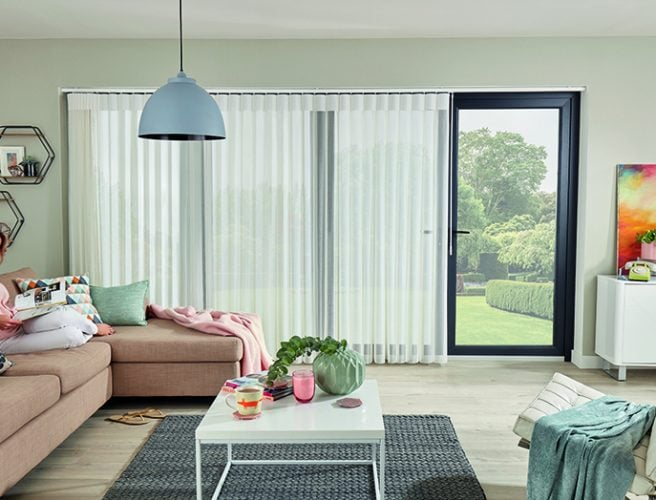 Allusion blinds covering bi-fold doors.
