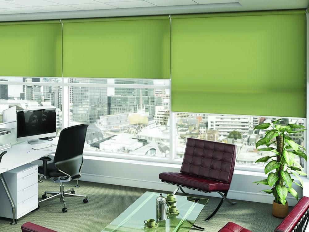Green roller blinds in an open plan office