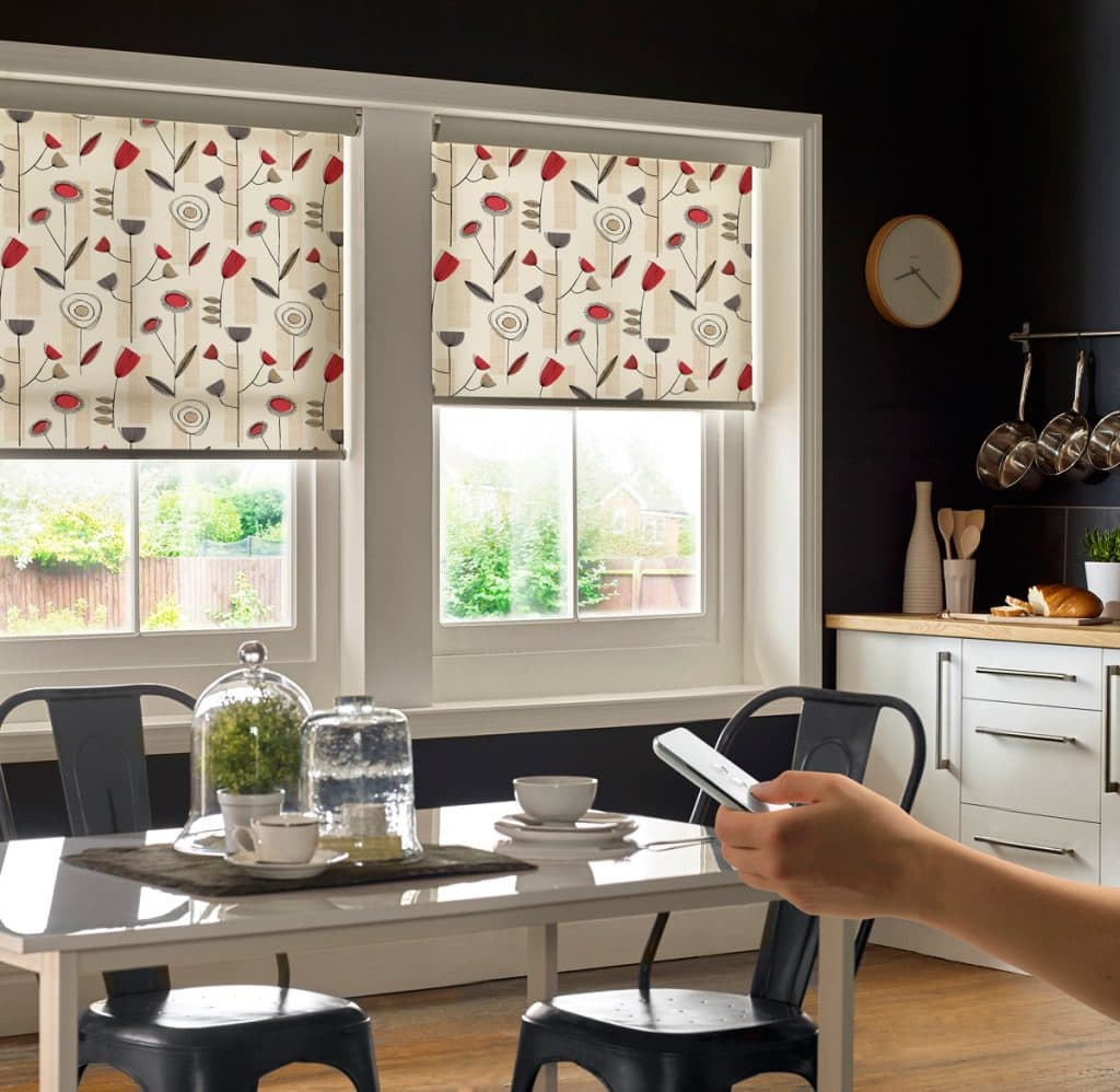 Kitchen motorised blinds with modern red and grey pattern on cream background