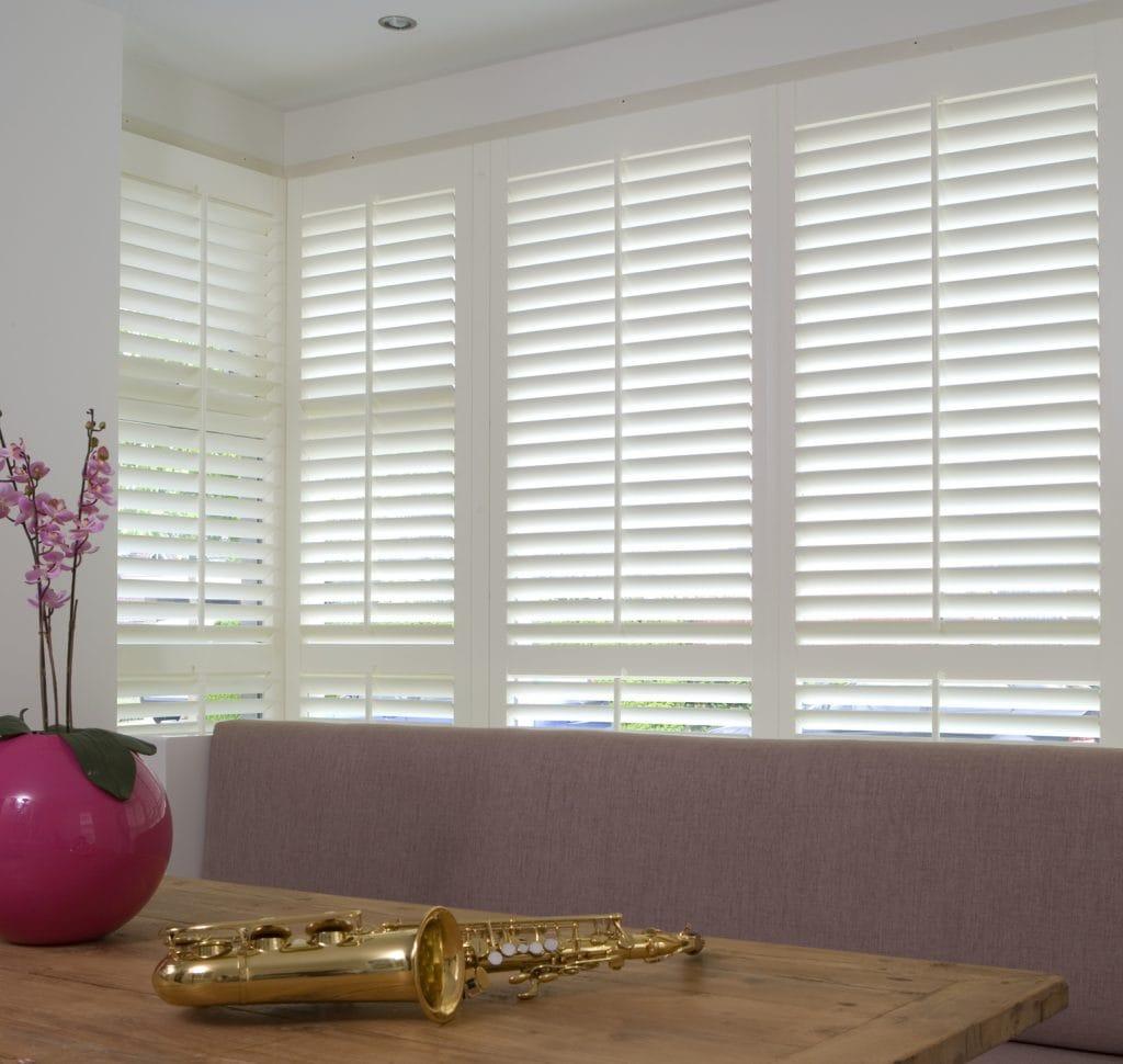 white shutters in bay window