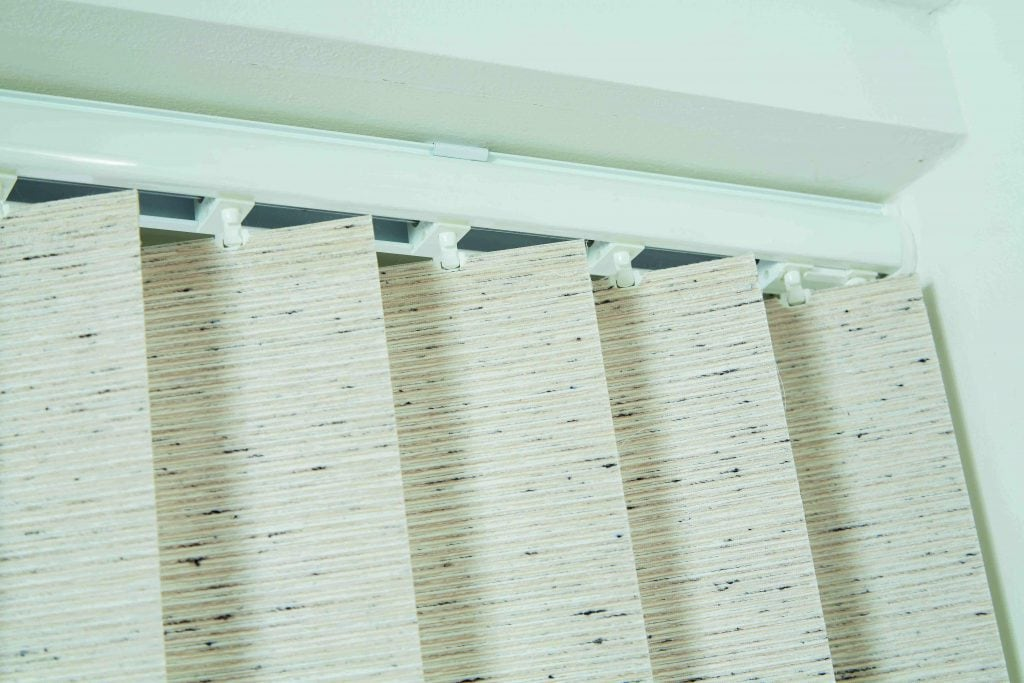 Close up of sand coloured vertical blinds