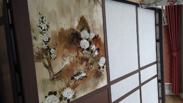 close up of shoji blind display showing Japanese pattern and plain blinds