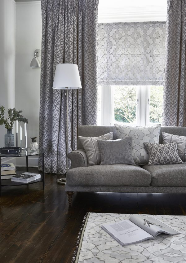 Grey roman blinds and curtains in living room