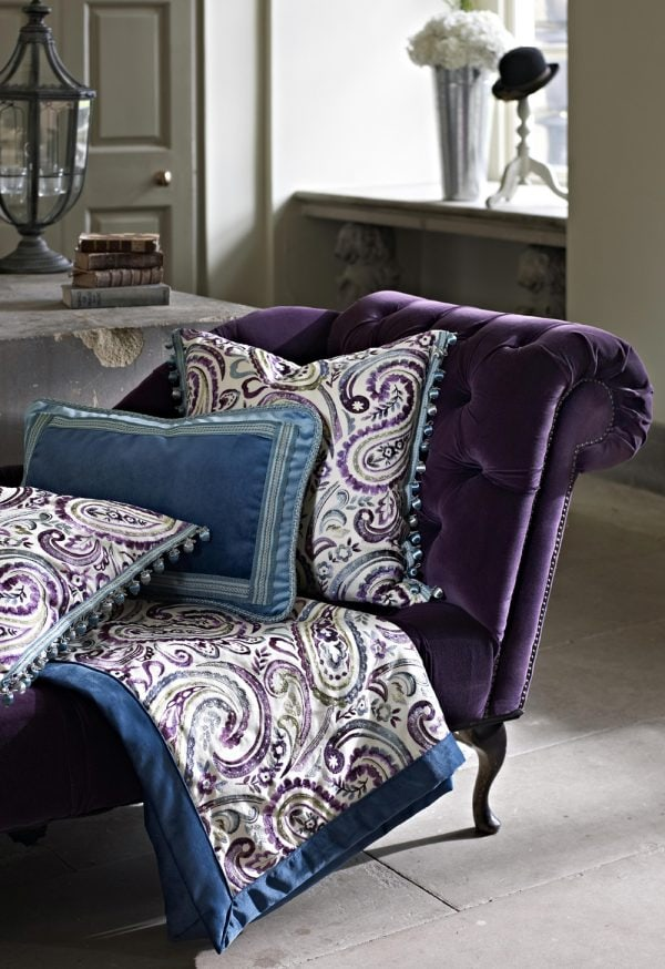 Purple velvet patterned cushions and throw on chaise lounge - Fabrics Norfolk - Norwich Sunblinds