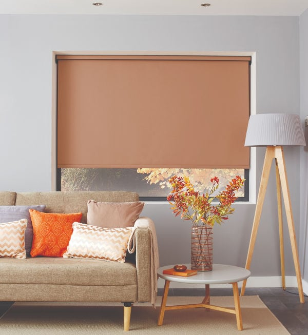 Copper coloured roller blind in living room