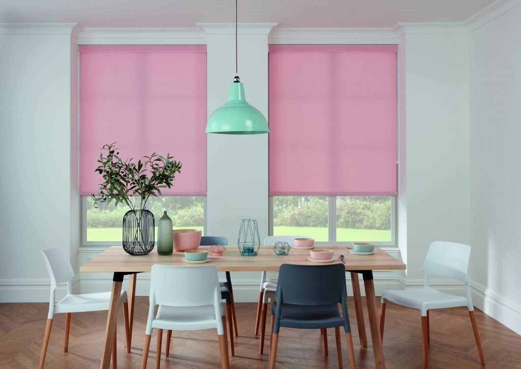Pink roller blinds look gorgeous with pastel and grey home accessories