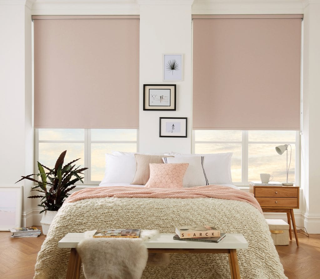 Blush tone roller blinds help to create a calming bedroom